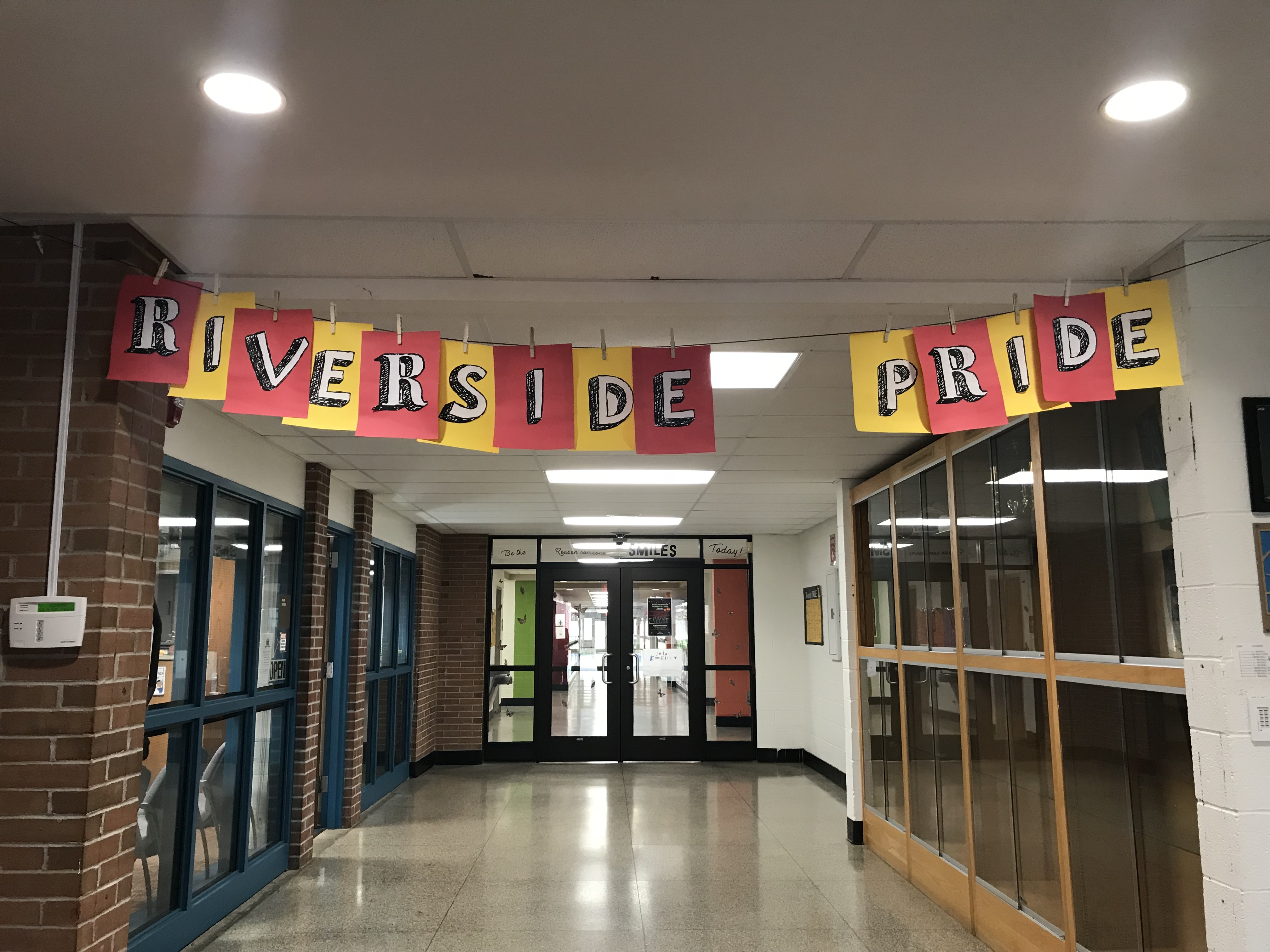 Entryway for Riverside Intermediate School. Has a banner saying