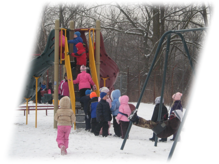 Elementary students playiing in the playground during the winter